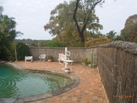 Pool-fenced-with-brushwood